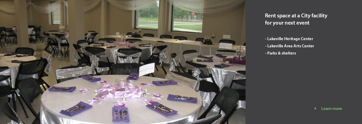 round tables set up with linens for an event